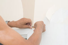 Hand Removal of wallpaper. Stock Images