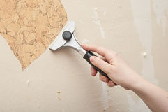 Hand removing wallpaper Stock Images