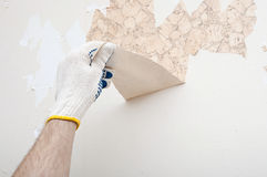 Hand removing wallpaper Stock Image