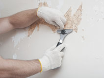 Hand removing wallpaper Royalty Free Stock Photography