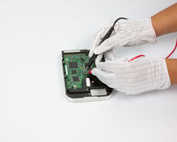 Hand repair electronic device Royalty Free Stock Image