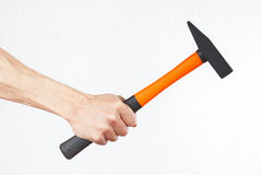Hand of repairman holding a hammer Royalty Free Stock Photos