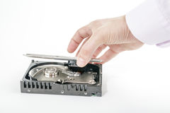 Hand repairman opens the top cover of the 3.5 inch HDD. Stock Images