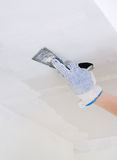 Hand repairs gypsum plasterboard frame Stock Photo