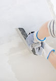 Hand repairs gypsum plasterboard frame. With spackling paste Stock Images