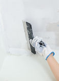 Hand repairs gypsum plasterboard frame Royalty Free Stock Image