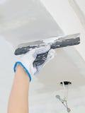 Hand repairs gypsum plasterboard frame Stock Image