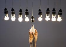 Hand replacing light bulb stock photo