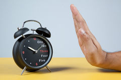 Hand resisting a clock Royalty Free Stock Photography