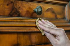 Antique wood furniture restoration. Hand restoring an old wood furniture Stock Photo