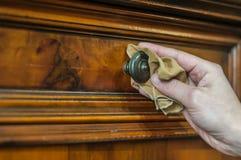 Furniture restoration. Hand restoring an old wood furniture Stock Photos