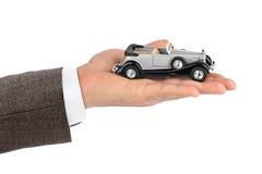 Hand with retro car Royalty Free Stock Photos