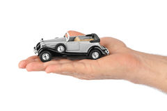 Hand with retro car Royalty Free Stock Photo