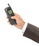 Hand with retro mobile phone Stock Photo