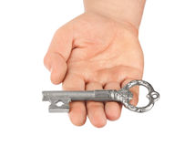 Hand with retro silver key Royalty Free Stock Image