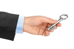 Hand with retro silver key Stock Photo