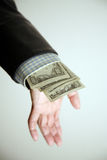 Hand revealing money Stock Photography