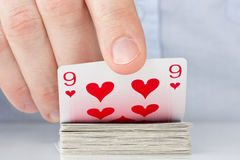 Hand revealing nine of hearts Royalty Free Stock Photo