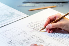 Hand reviewing construction plans. Stock Photos