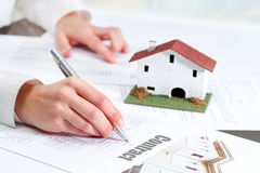 Hand reviewing housing contract. Close up of female hand reviewing real estate contract royalty free stock photos