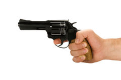 Hand with revolver gun. Isolated on white background Stock Images