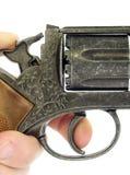 Hand with revolver gun Stock Image