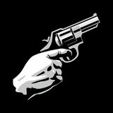 Hand with revolver gun isolated on black background Royalty Free Stock Images