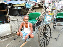 A hand rickshaw puller waits for passengers Royalty Free Stock Photography