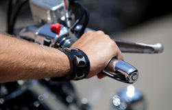 Hand rider on the handlebars Royalty Free Stock Photo