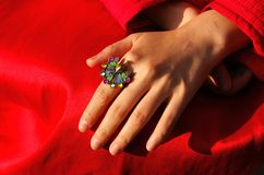 The hand and the ring. The hand and the peacock Royalty Free Stock Photography