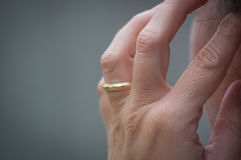 Hand with ring. A person holding a hand with engagement ring on his or her temple Stock Photography