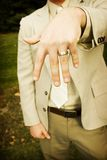 Hand and ring. Man holds up his wedding ring Stock Images