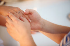 Hand with ring in hands of a man Royalty Free Stock Photo