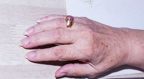 Hand with a ring. Senior female hand with a ring on her finger Royalty Free Stock Photos