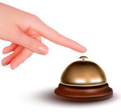 Hand ringing the bell to call Stock Photo