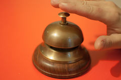 Hand ringing service bell royalty free stock image