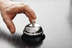 Hand ringing in service bell Stock Photo