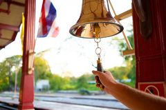 Hand rings the bell. Male hand is ringing the bell. royalty free stock photos