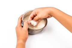 Hand rinses rise with water in a bowl in isolated white. Stock Image
