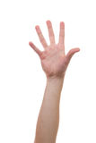 Hand rising and grabbing for other hands. Caucasian hand reaching for another person or body part Stock Photo