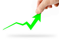 Hand rising green business graph Stock Images