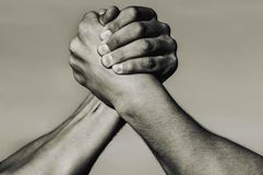 Hand, rivalry, vs, challenge, strength comparison. Two muscular arm. Rivalry concept. Man hand. Two men arm wrestling royalty free stock photo
