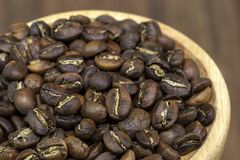Hand roasted coffee with frying pan sort dry process or natural. Process in wooden tray on wood table stock photography