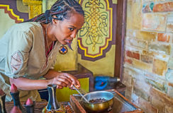 The hand roasting of coffee. KIEV, UKRAINE - JUNE 4, 2017: The traditional Ethiopian coffee ceremony include the hand roasting, the participants can enjoy the Stock Images