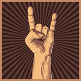 Hand in rock sign background. Royalty Free Stock Photo