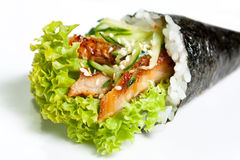 Hand Roll Sushi with eel. Lettuce, avocado, cucumber and nori close-up stock images