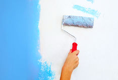 Hand with roller brush painting Royalty Free Stock Image