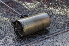 Hand roller for mastic asphalt paving Stock Image