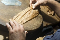 Hand rolling cigar production Royalty Free Stock Photography