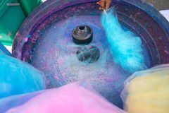 Hand rolling cotton candy in candy floss machine. Candyfloss making stock image